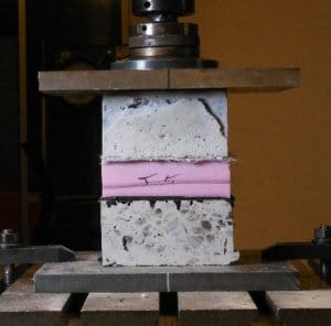 stiffness testing of combined concrete, insulation, drainage board, and waterproofing system