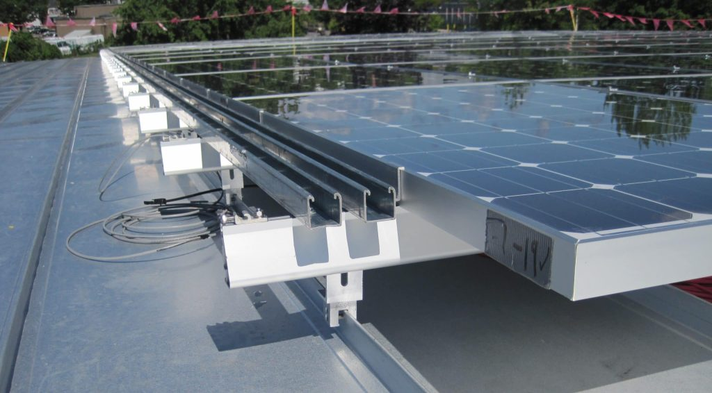 Understanding How Photovoltaic Systems Affect Low-Slope Roofing Projects